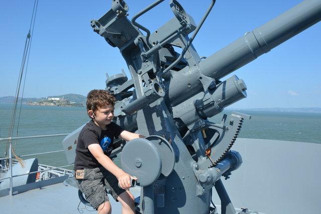 Calvin on the deck gun on SS Jeremiah O'Brien