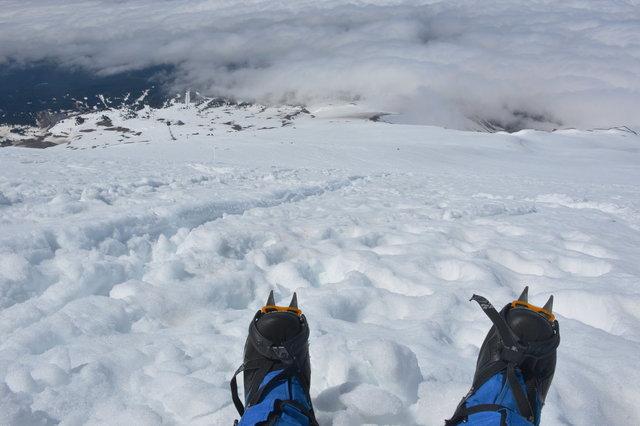 Jaeger's boots and crampons descending Mount Hood