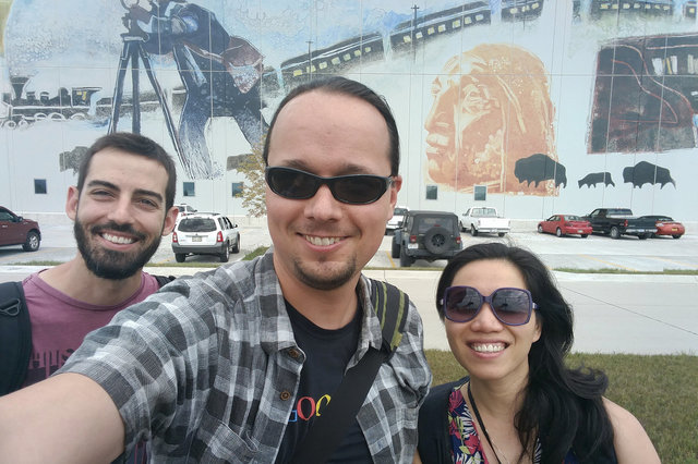 Yannis, Jaeger, and Yang at the data center mural