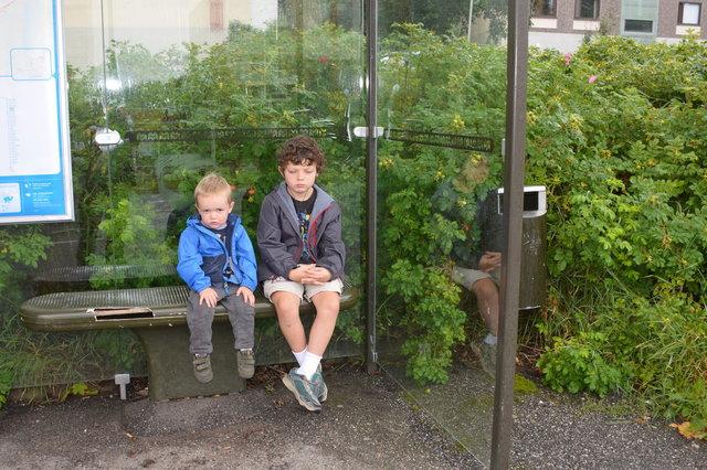 Julian and Calvin wait for the bus in Helsinki