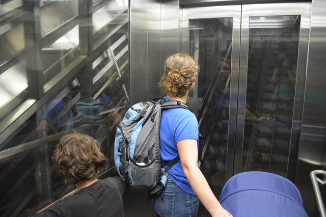 Calvin and Kiesa ride the diagonal elevator