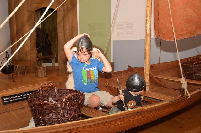 Calvin and Julian in a Viking longboat