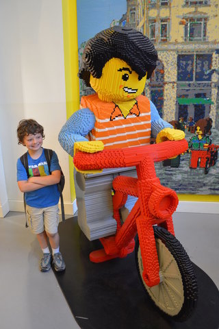 Calvin with a life-sized Lego minifig on a bicycle