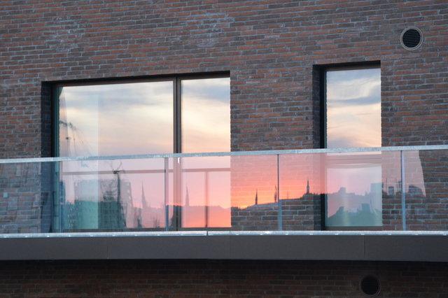 Copenhagen sunset reflected in balcony