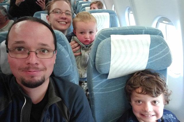 Jaeger, Kiesa, Julian, and Calvin on Finnair flight 12 to Helsinki