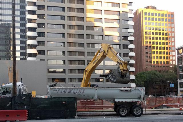 Excavating steel pilings