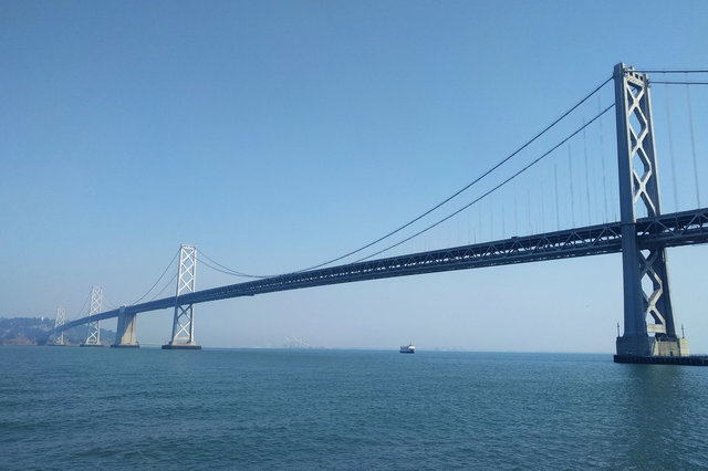 Bay Bridge with Oakland shrouded in haze