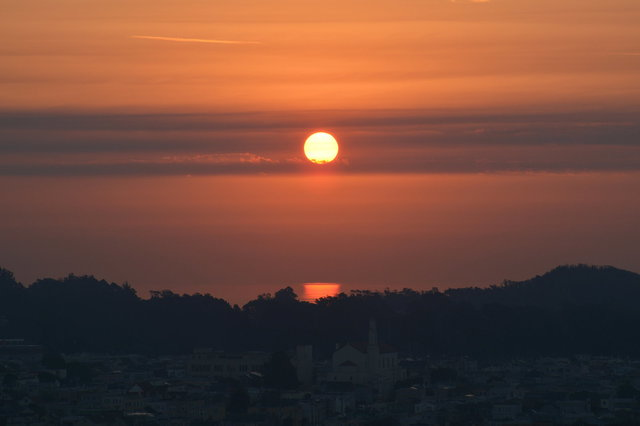 Red sun rises over San Francisco Bay