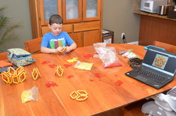Calvin assembles a Lego polyhedra