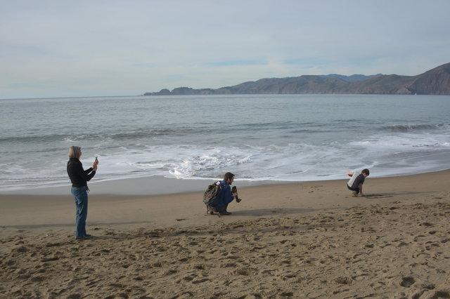 Nana photographs Willy photographing Calvin on Baker Beach