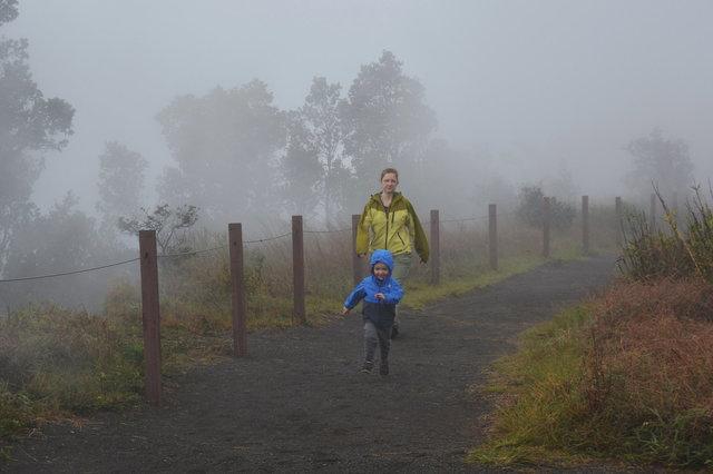 Julian runs in front of Kiesa on the Steaming Bluff above Kilauea Caldera