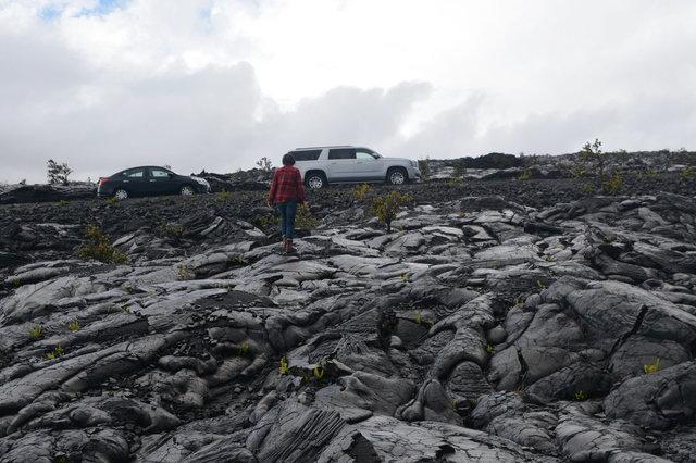 Sasa walks back to the car over 1972 lava