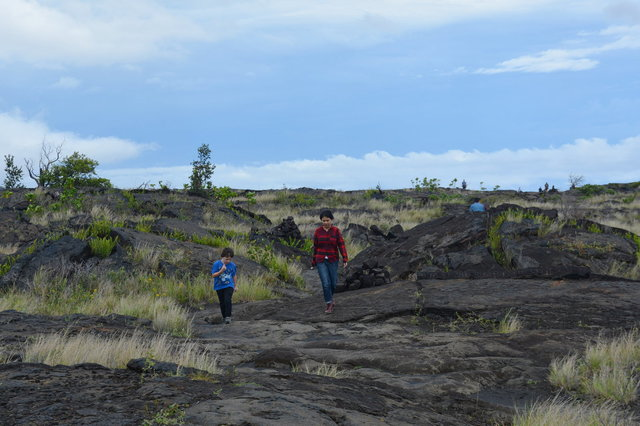 Calvin and Sasa walk back across lava
