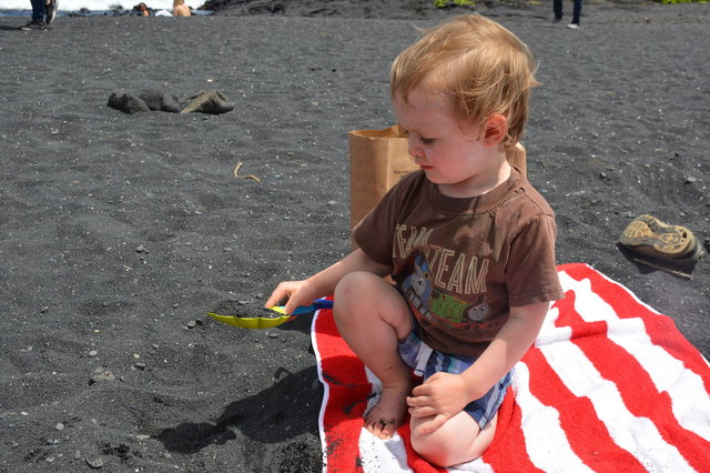 Julian digs on Punalu'u Black Sand Beach
