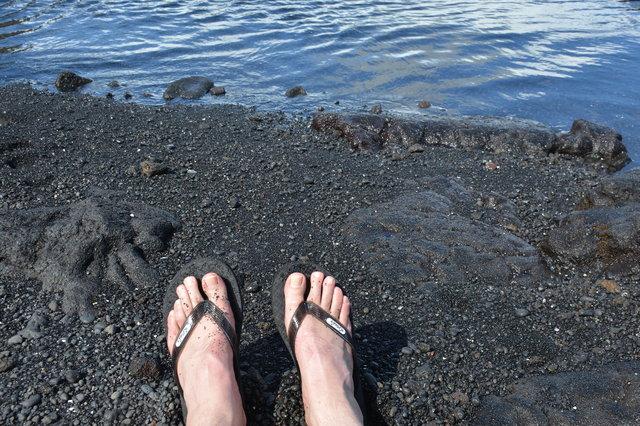 Jaeger's sandals on Punalu'u Black Sand Beach