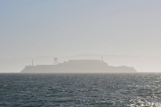 Alcatraz lurking in the morning haze on San Francisco Bay