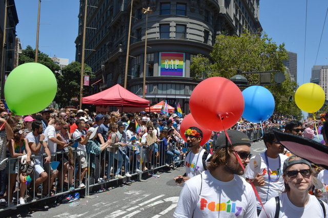 Crowd watches Googlers marching down Market Street for Pride