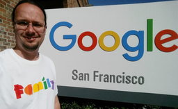 Jaeger in front of the Google San Francisco sign for Pride