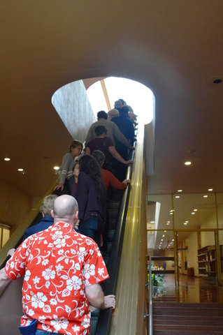 Tour guests ride the escalator into the Marin County Civic Center