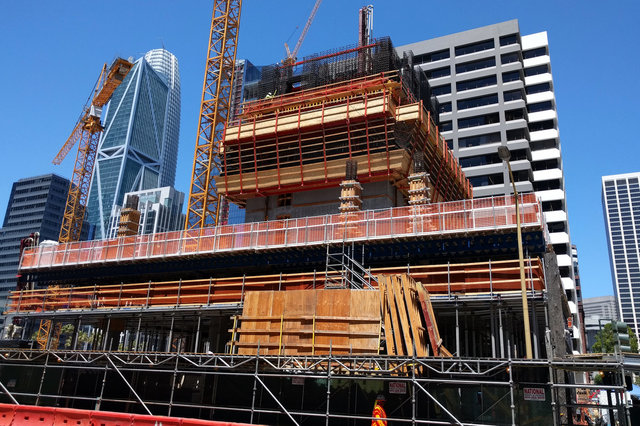 Core of the Folsom Bay Tower climbs above street level