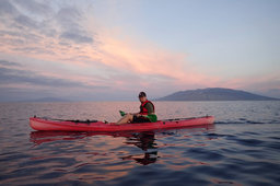 Jaeger paddles in front of West Maui