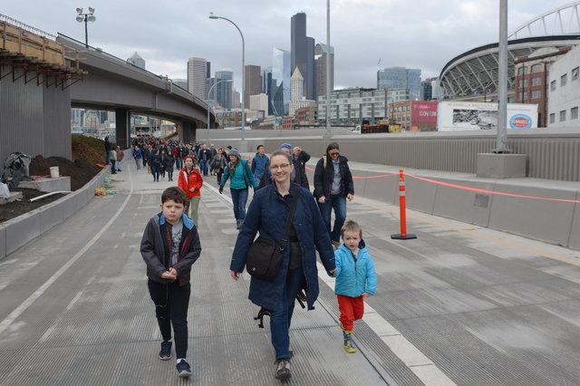 Calvin, Kiesa, and Julian walk from the SR-99 tunnel in SoDo