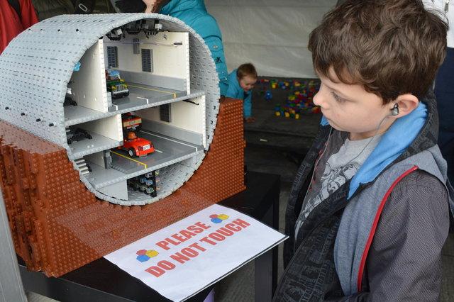 Calvin studies a Lego model of the SR-99 tunnel