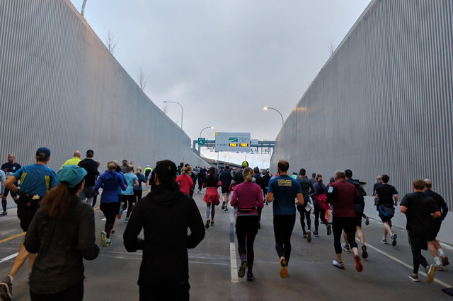 Runners emerge from the SR 99 tunnel south portal
