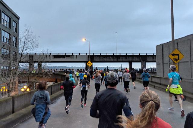 Runners climb the ramp to the Alaskan Way Viaduct