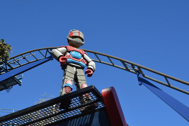 Lego Technic figure in front of the Technic coaster