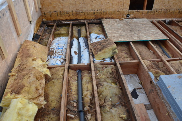 Drain pipe and insulation exposed on Wallingford's roof