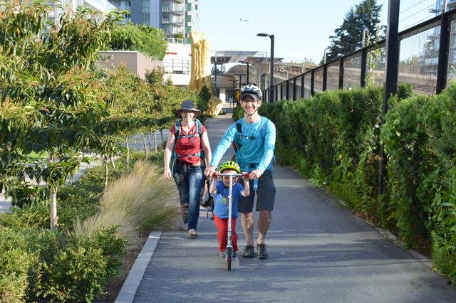 Kiesa, Julian, and Uncle Tristan on the sidewalk in Vancouver