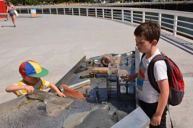 Calvin and Julian play with the outdoor water table at Science World