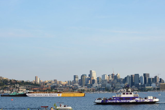 UW ferry cruises past the fireworks barge in Lake Union