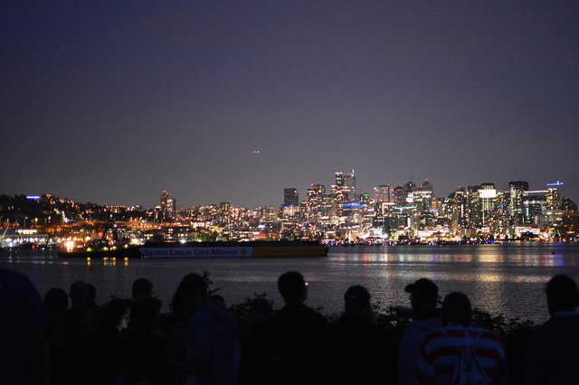 Fireworks barge in Lake Union after dark
