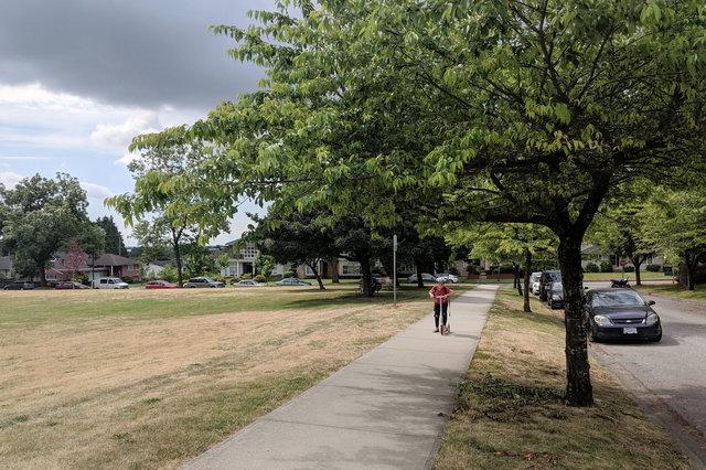 Calvin rides a scooter in Winona Park