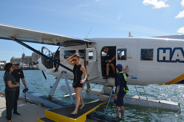 Passengers disembark from a DHC-3T