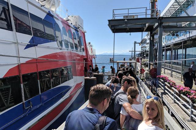 Passengers board the Victoria Clipper V in Seattle
