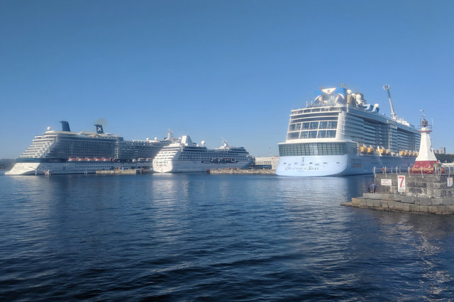 Celebrity Solstice, Regatta, and Ovation of the Seas docked at Victoria's cruise ship terminal