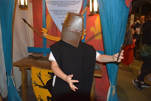 Calvin takes a selfie as an armored knight