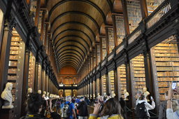 Tourists inside the Long Library at Trinity College Dublin