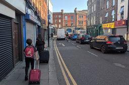 Calvin and Kiesa walk down Meath St in Dublin