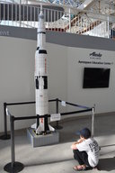 Calvin with a Lego Saturn V model