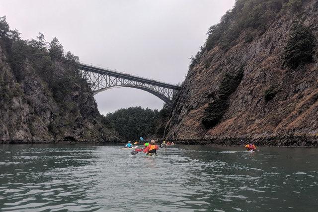 Kayakers paddle through Canoe Pass