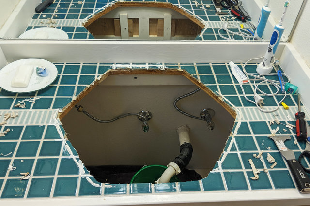Tile caulked into place in bathroom sink