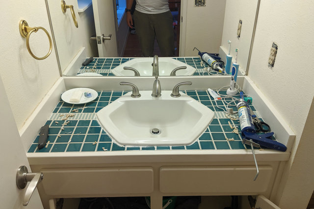 Bathroom sink dropped into place with new faucet