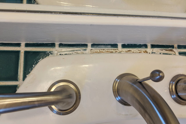 Poorly-installed bathroom sink tile