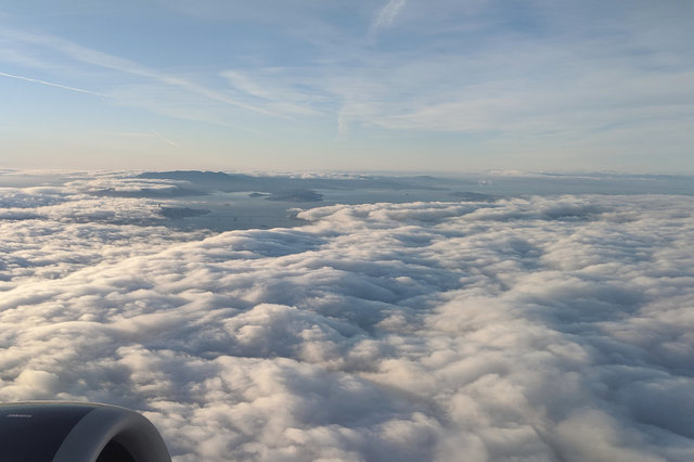 Climbing out of SFO above the clouds