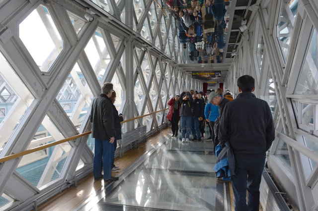 Tourists on the glass floor on the Tower Bridge