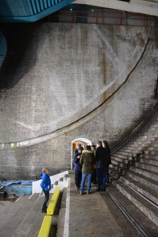 Tourists congregate in the bascule chamber under the Tower Bridge